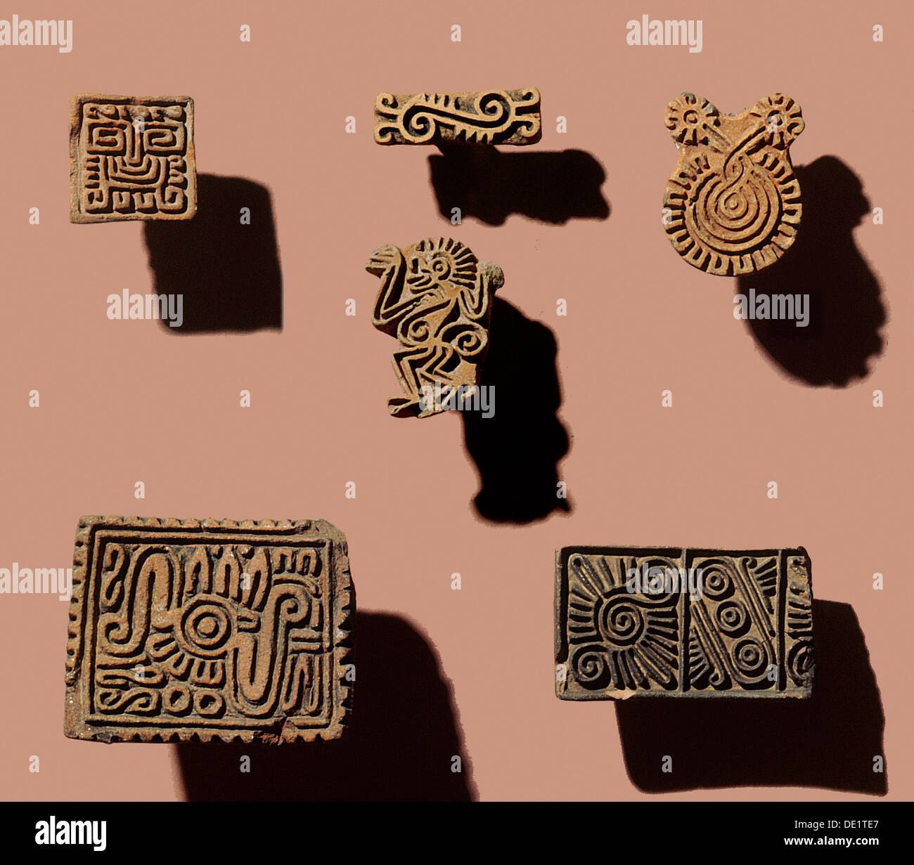 When attending festivals, the Aztecs wore face-paint and probably used small pottery stamps such as these to imprint patterns on - Stock Image