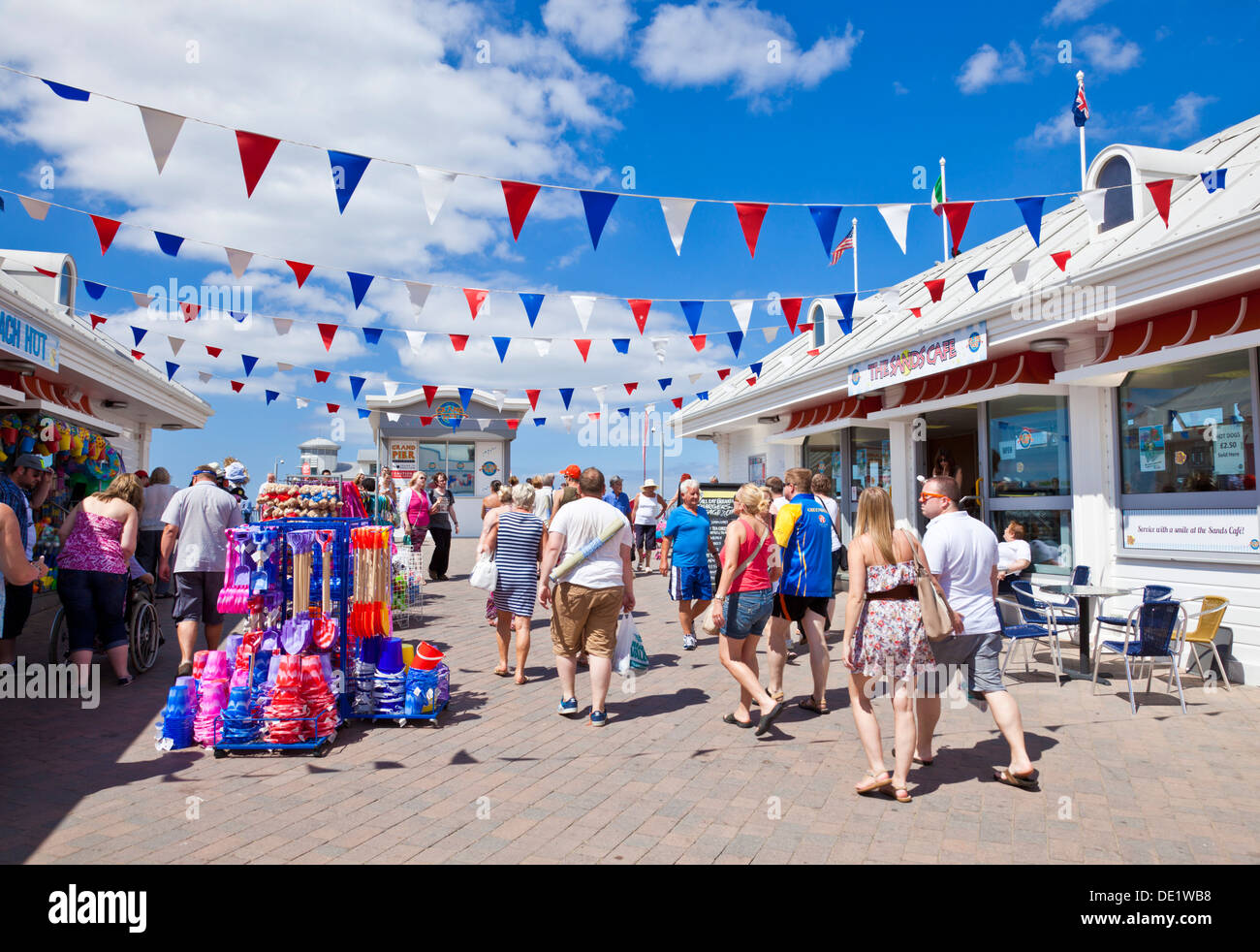 Tourists walking onto Weston Super Mare Grand Pier Weston-Super-Mare Somerset England UK GB EU Europe - Stock Image