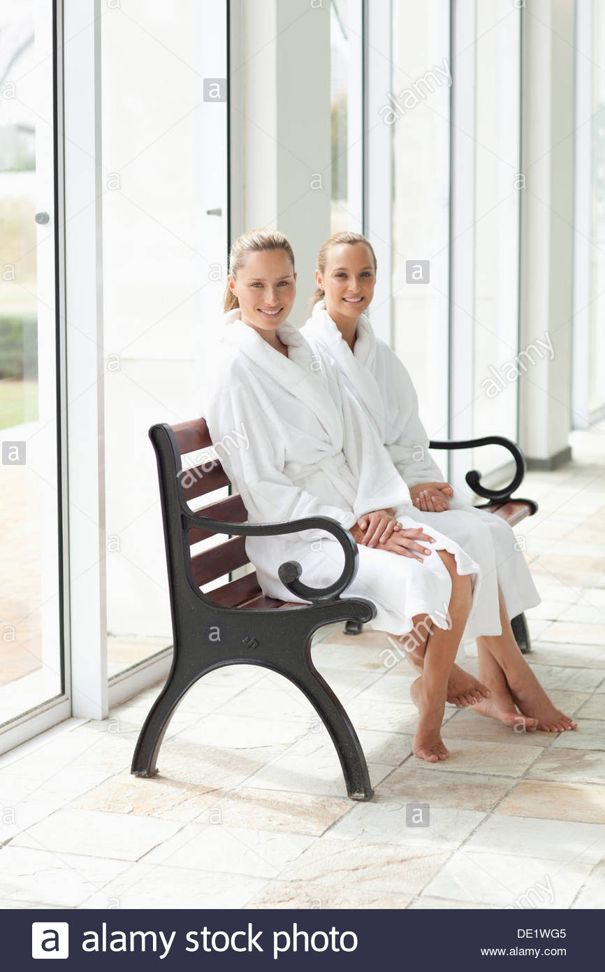 Portrait of smiling women in bathrobes at spa Stock Photo