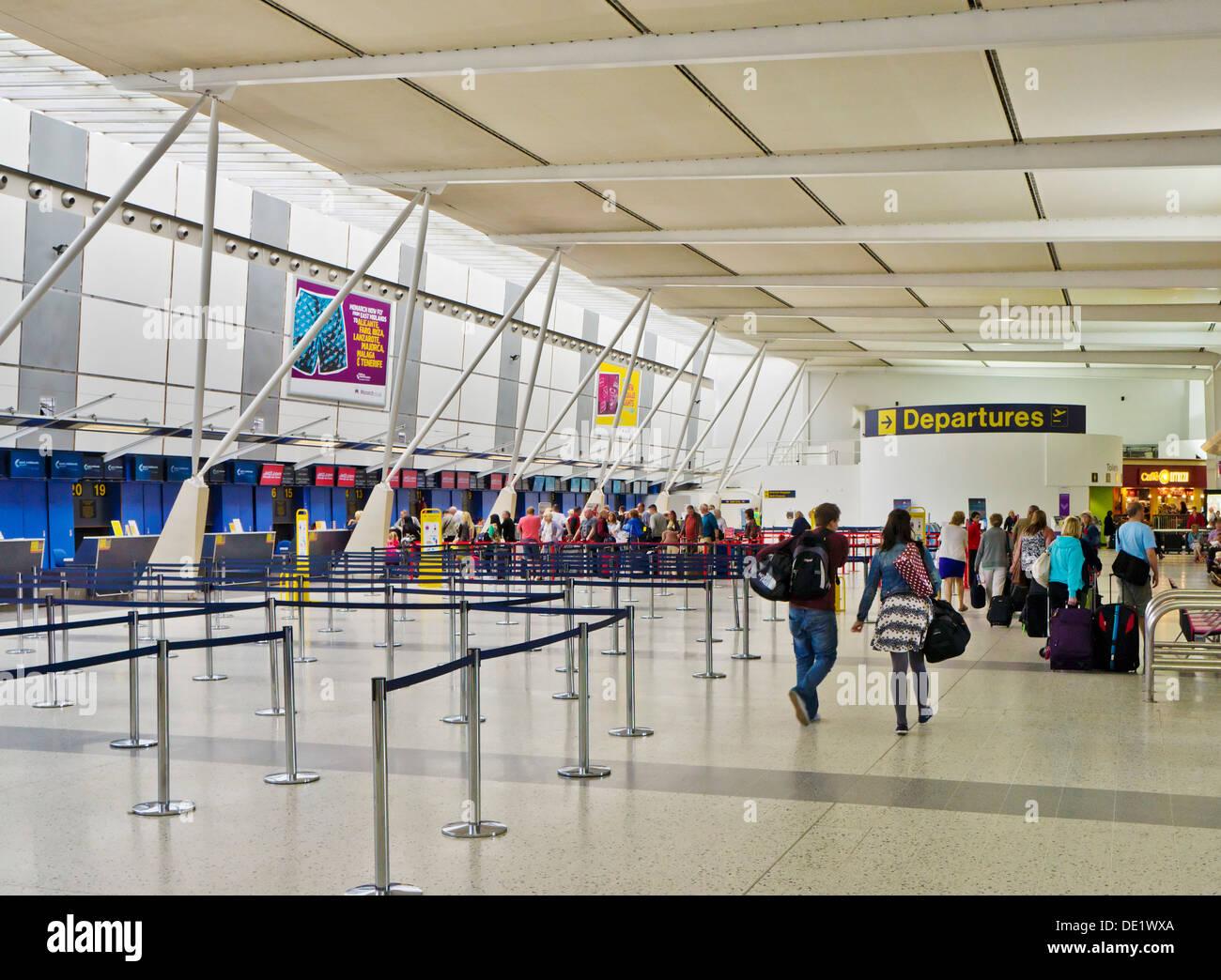 East Midlands airport check in lines to desks area Castle Donnington Derbyshire England UK GB EU Europe - Stock Image