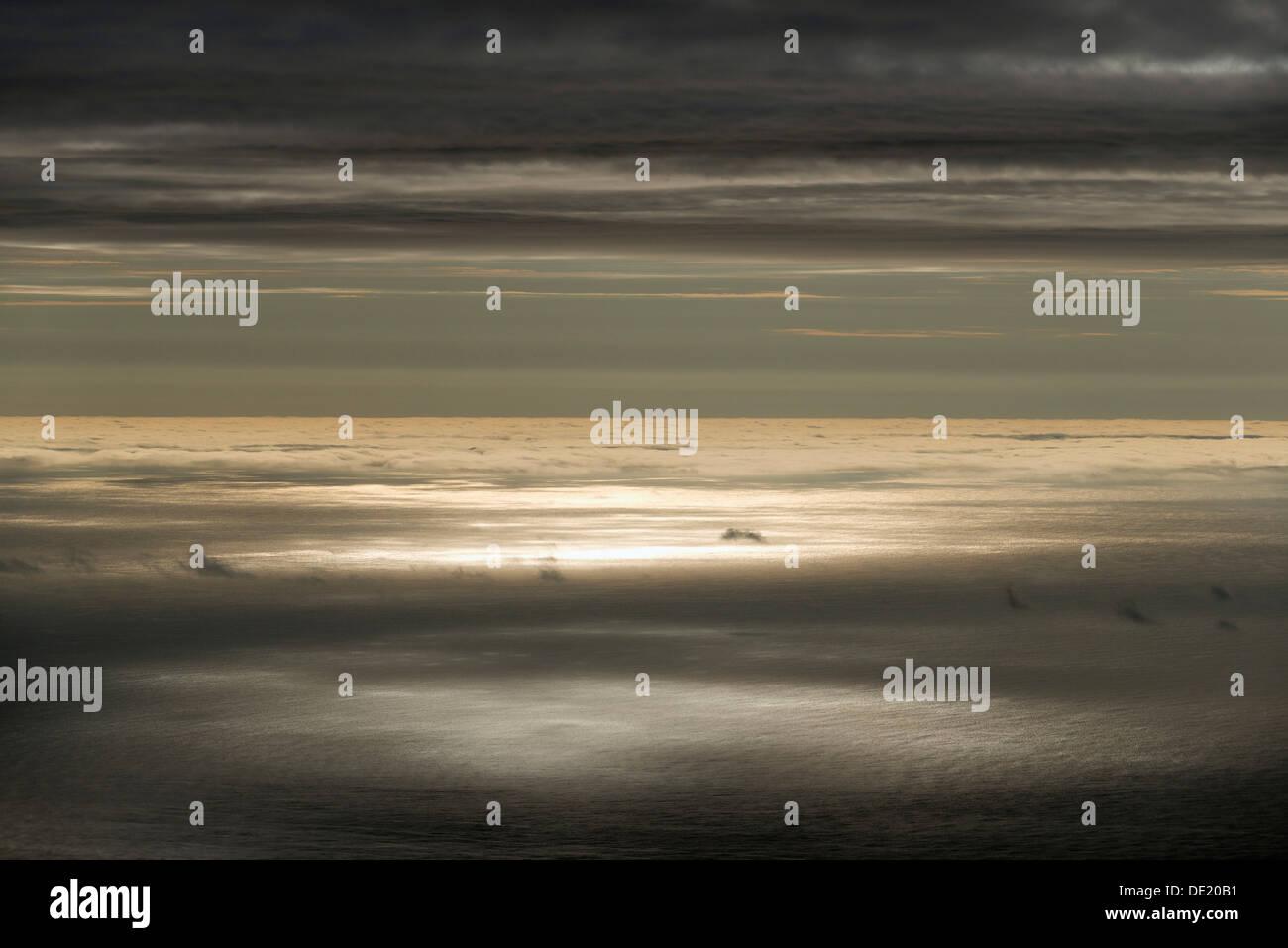 Sun reflecting on the surface of the sea, clouds, Eysturoy, Faroe Islands, Denmark - Stock Image