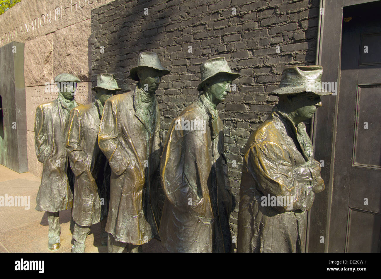 Sculptures of men in a bread line during the Great Depression, Franklin D. Roosevelt Memorial, Washington, District of - Stock Image