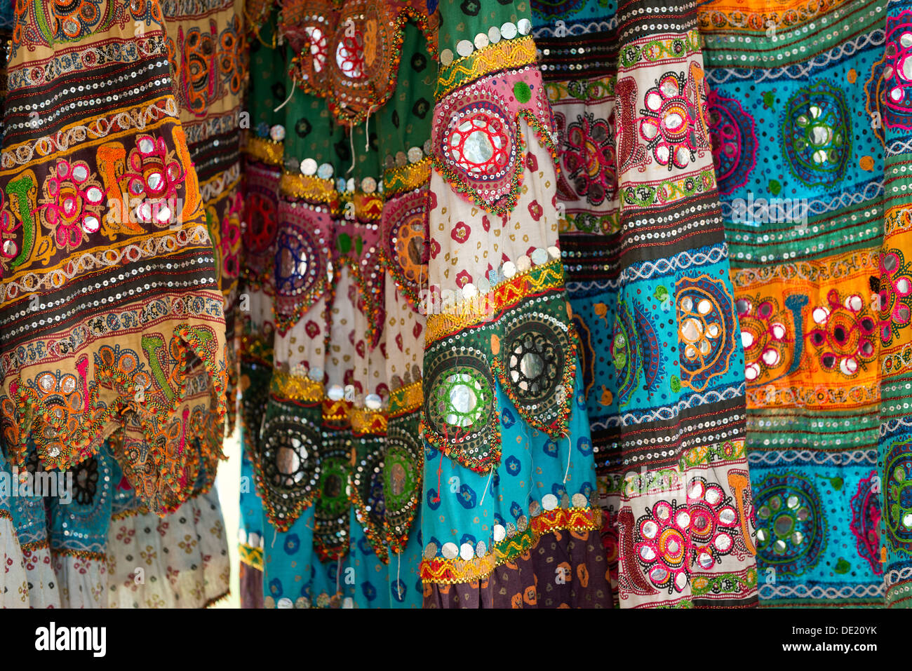 Colourful skirts inlaid with mirrors and different patterns, detail, Udaipur, Rajasthan, India - Stock Image