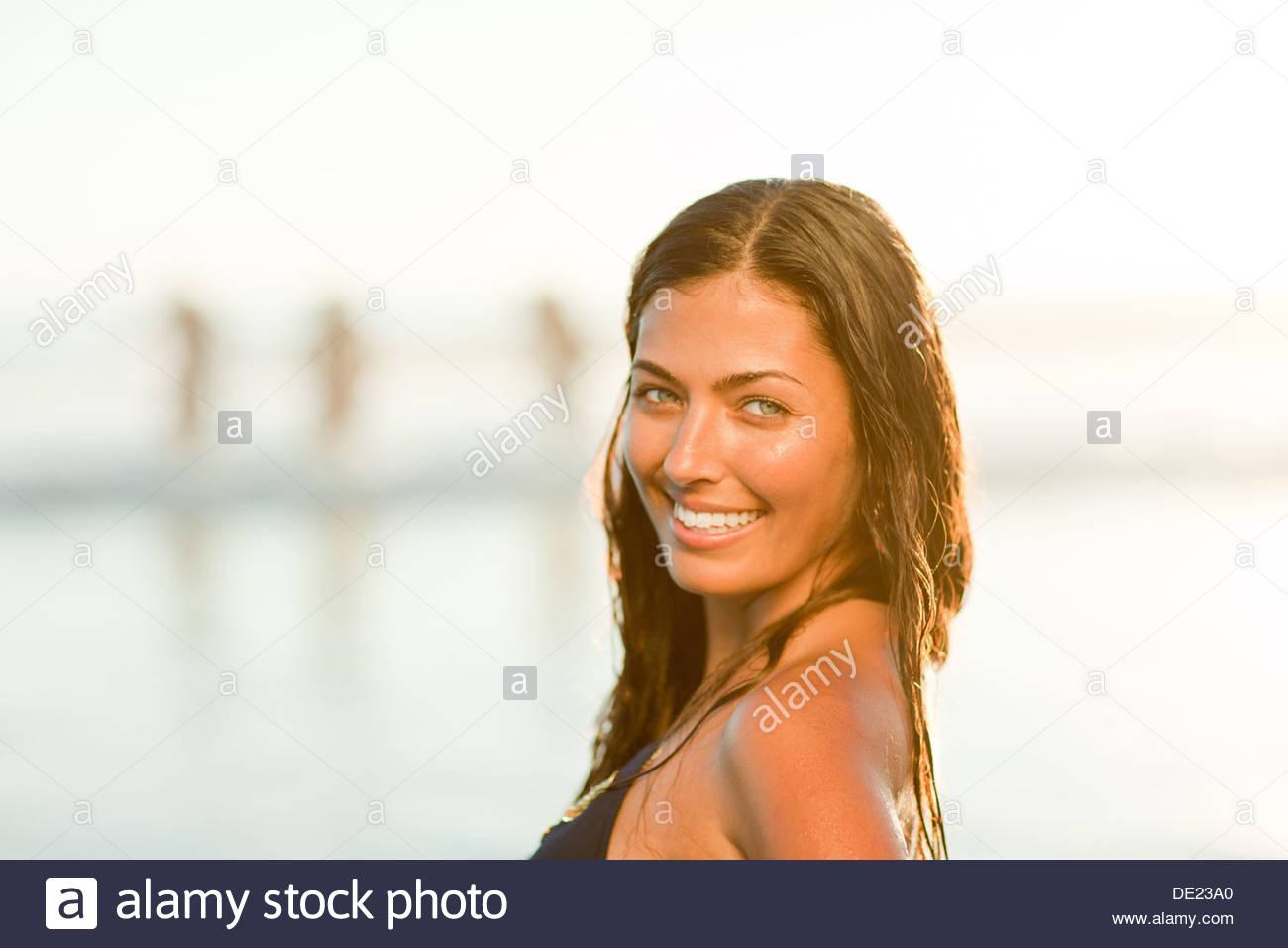 Woman wearing bikini on beach - Stock Image