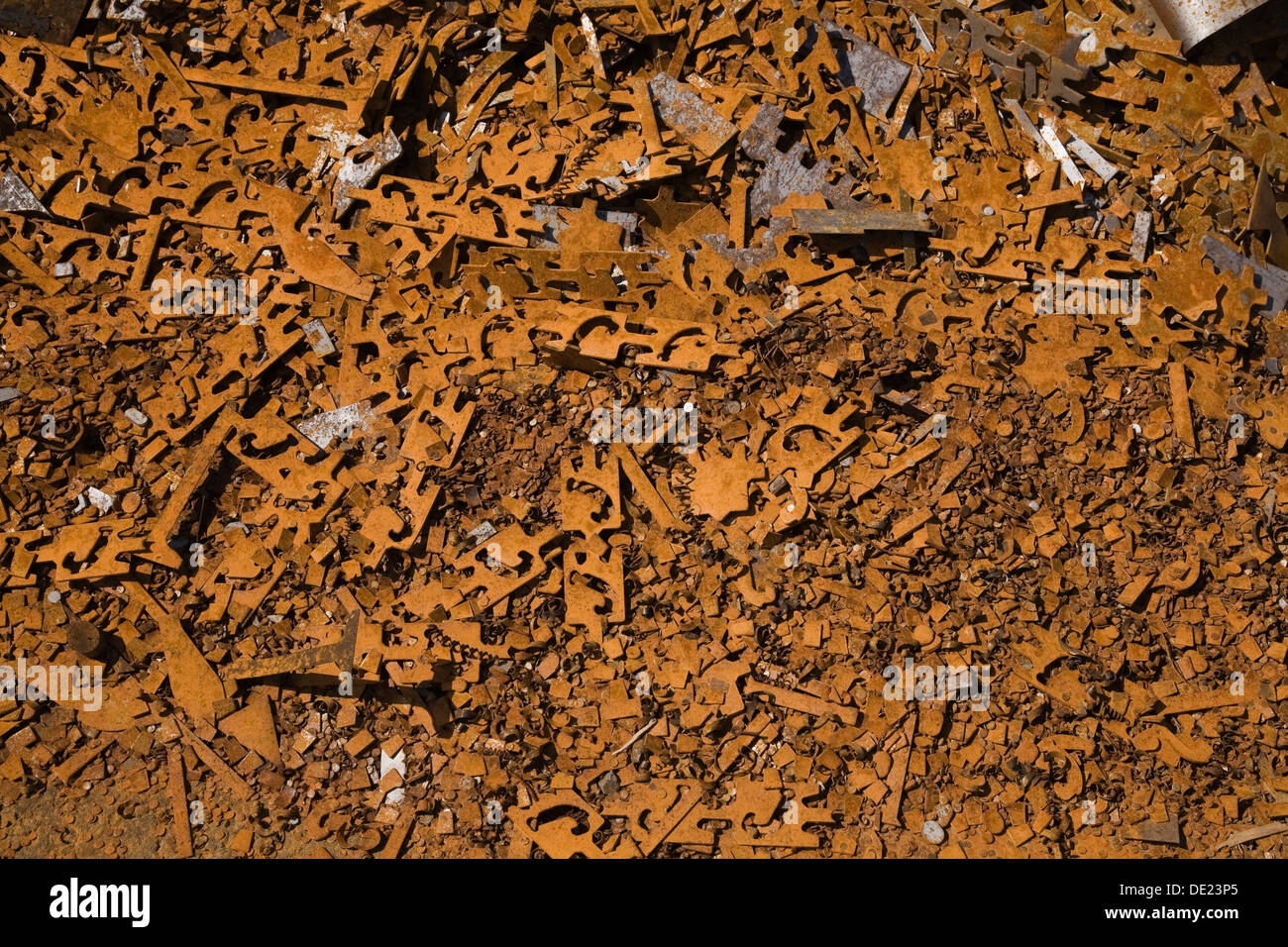 Assorted rusted metal brackets at a scrap metal recycling junkyard, Quebec, Canada Stock Photo