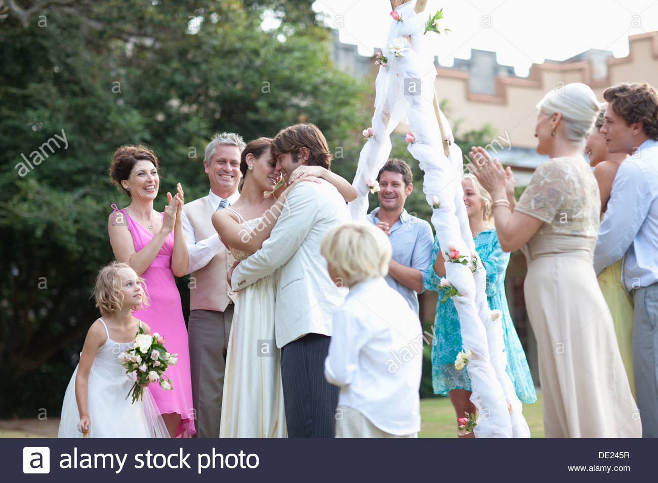 Guests watching bride and groom - Stock Image