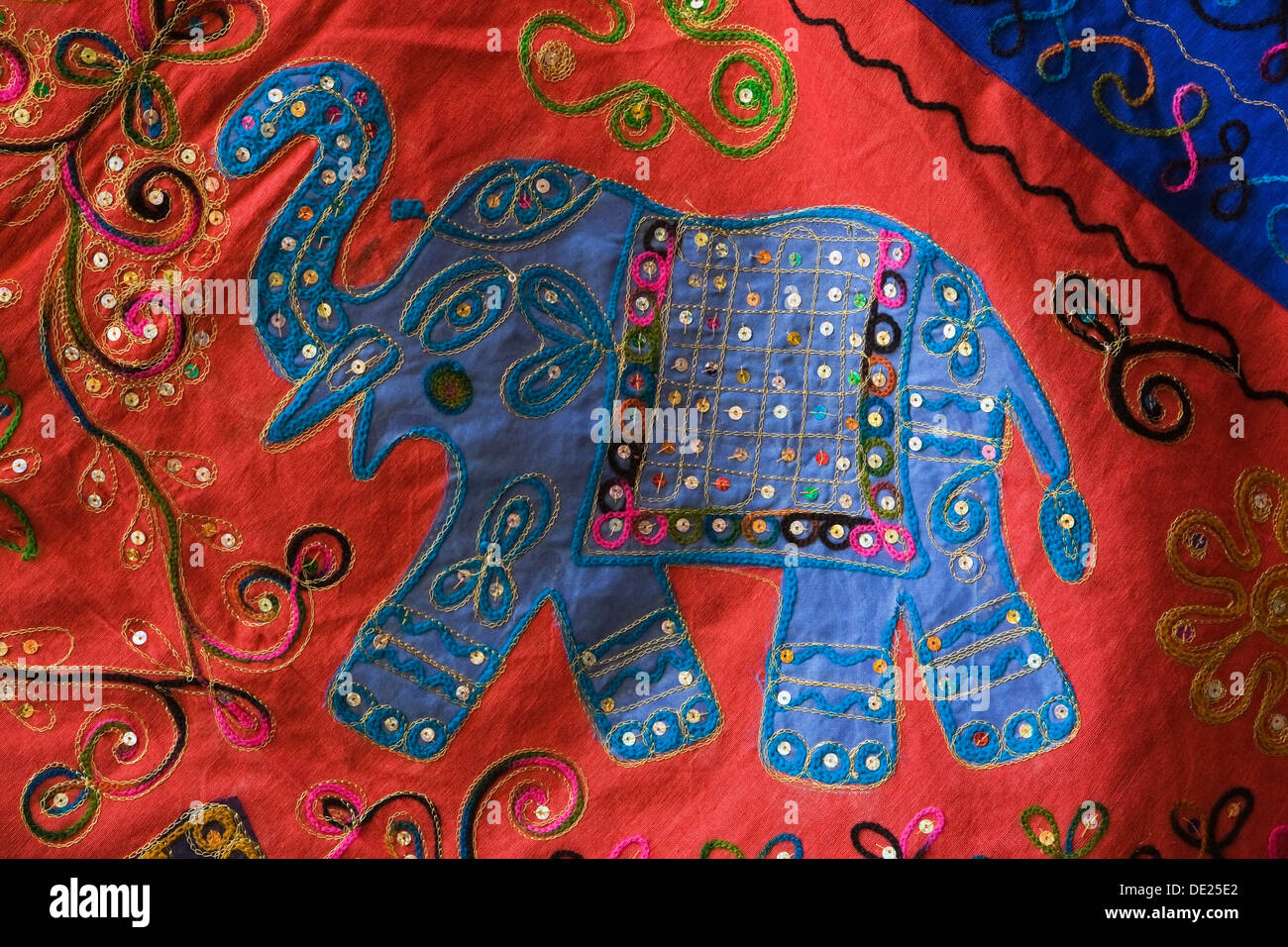 Embroidered elephant on a piece of cloth, at an Arab souk, Granada, Granada province, Andalusia, Spain - Stock Image