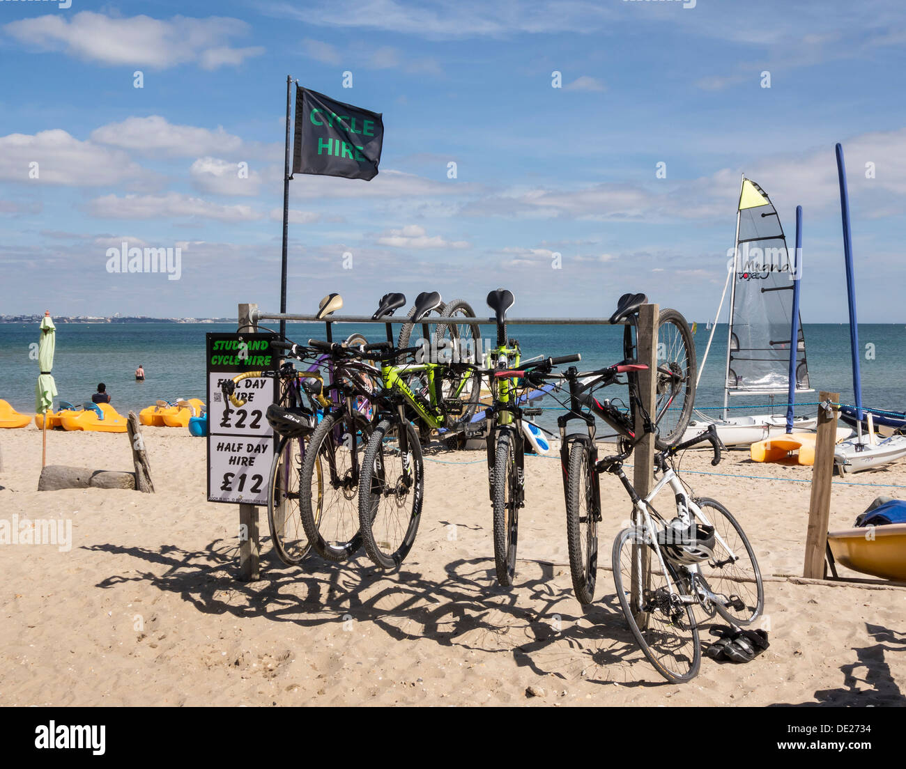 Studland Beach, Bikes for hire in a rack, Isle of Purbeck, Dorset, England, UK. - Stock Image