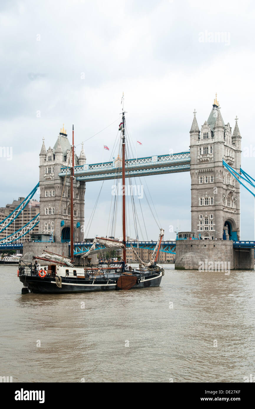 London, UK. 10th Sep, 2013. Tower Bridge, London. The bridge opens as two classic boats arrive during the Thames Stock Photo