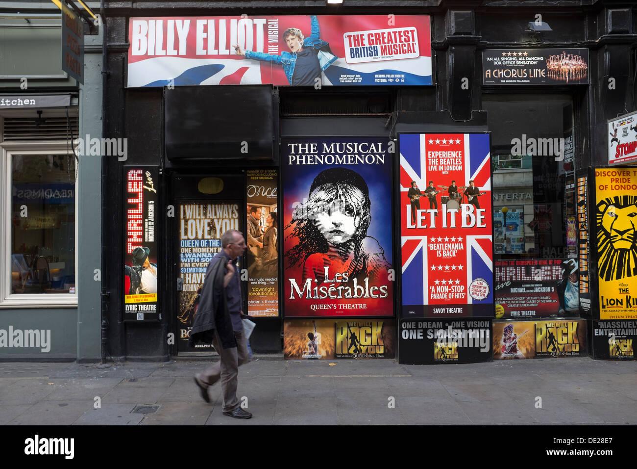 Man walks past Theatre Advertising Monmouth Street London