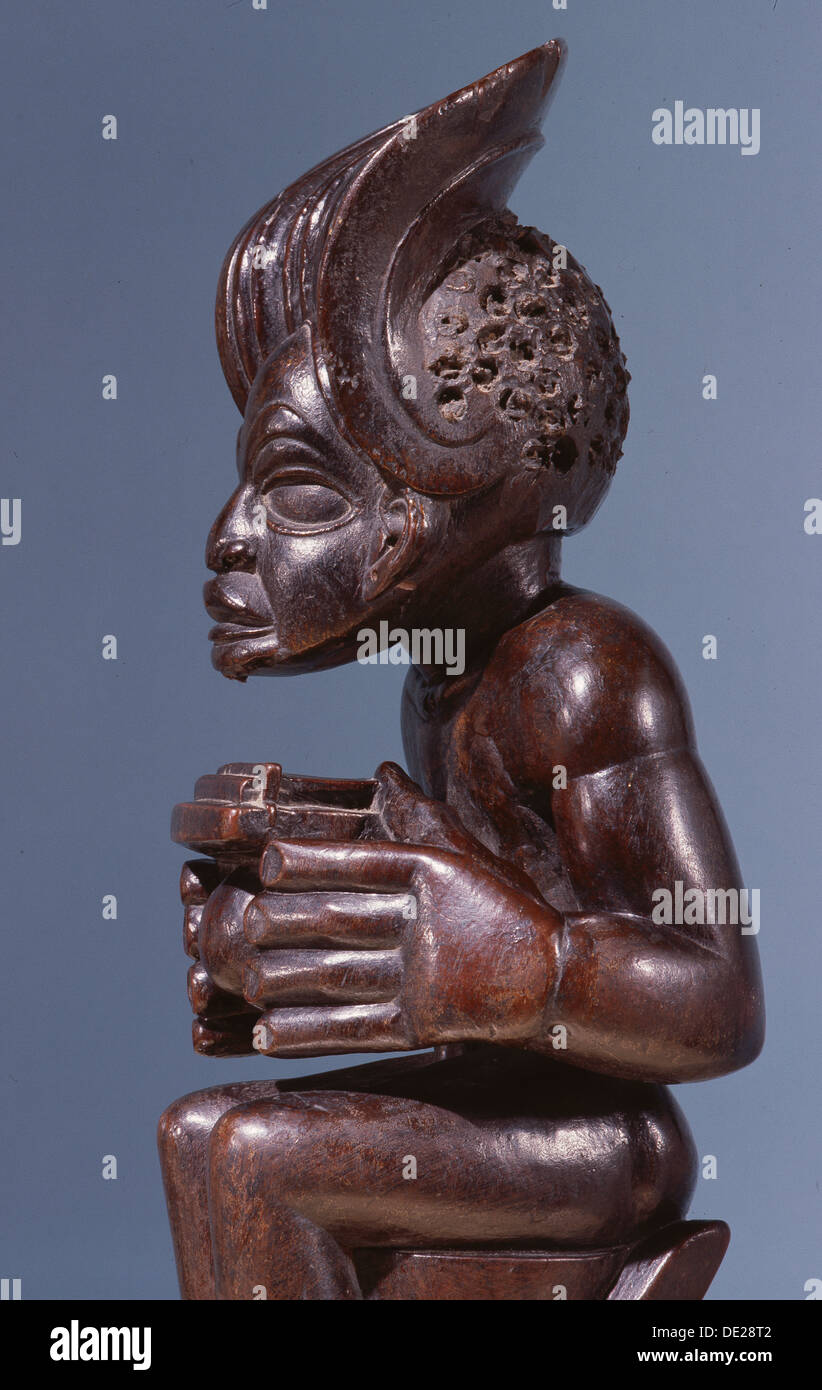 Chief holding a sanza, a musical instrument of the ideophone family, with metal keys and gourd resonator. - Stock Image