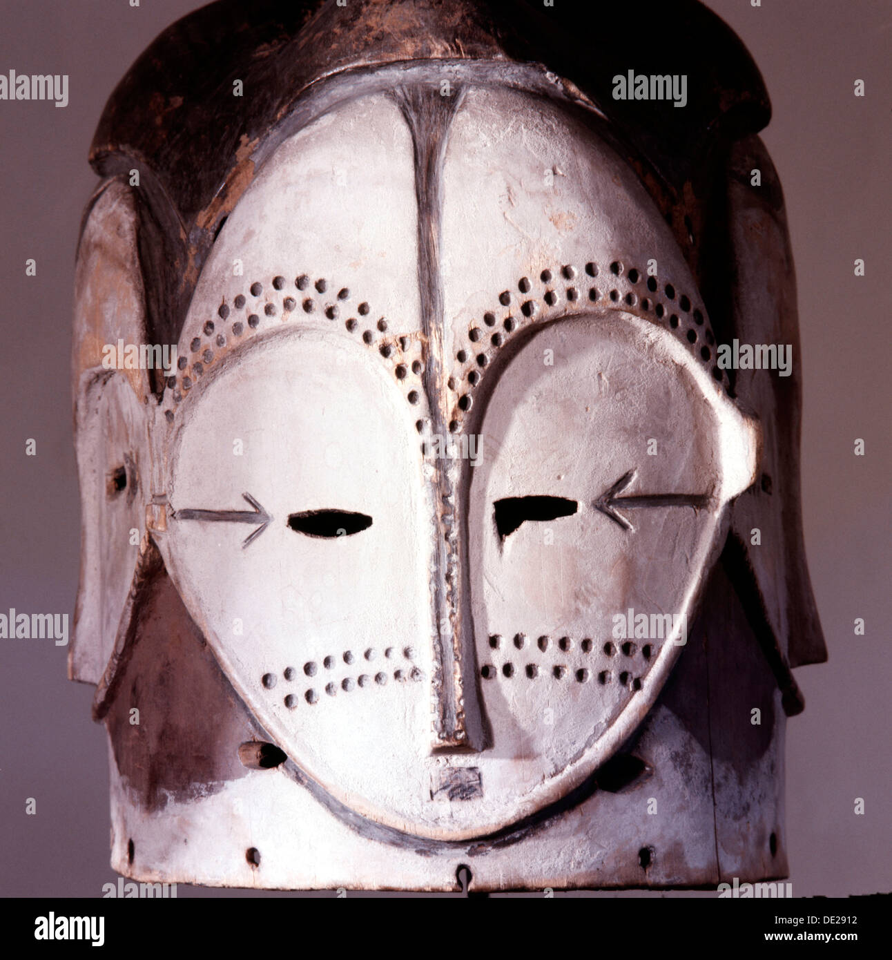 Four faced helmet masks such as this were used by the Fang Ngongtang society in anti witchcraft rituals. - Stock Image