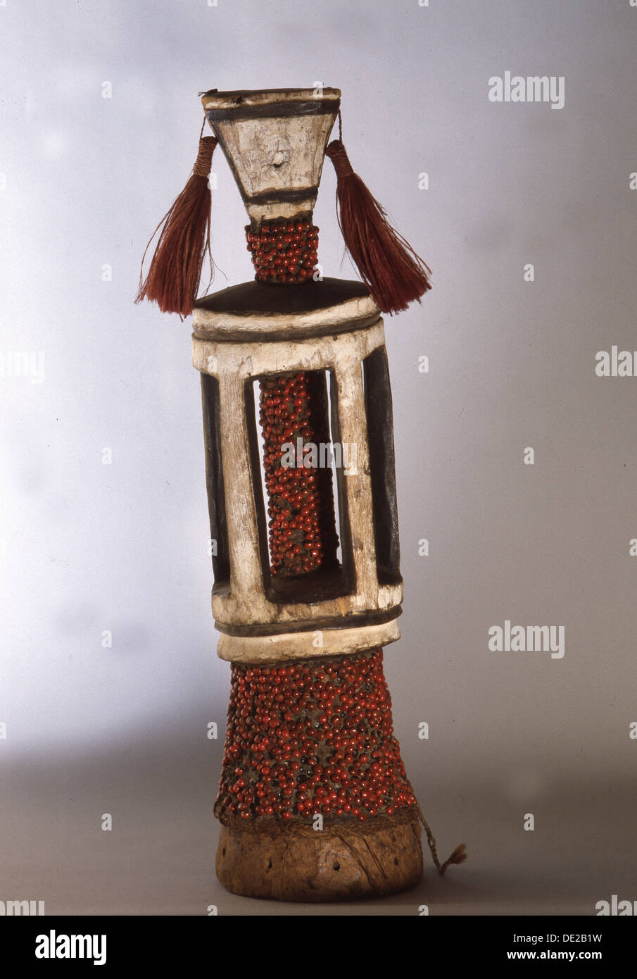 Stylised human figure covered with red abrus seeds. - Stock Image