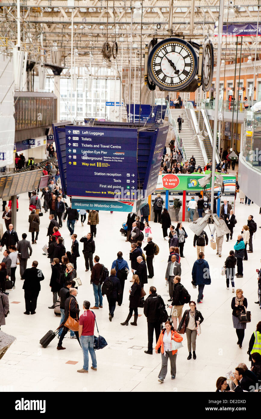 London Waterloo station; - Waterloo station concourse and clock with commuters at evening rush hour, London England UK - Stock Image