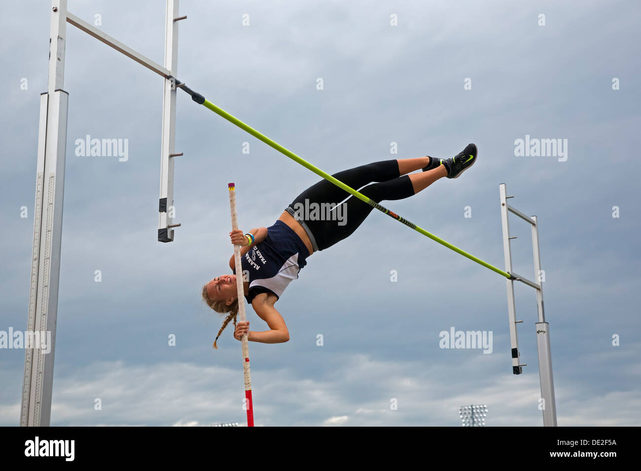 Ypsilanti, Michigan - Women's pole vault competition during the track and field events at the AAU Junior Olympic Games. - Stock Image