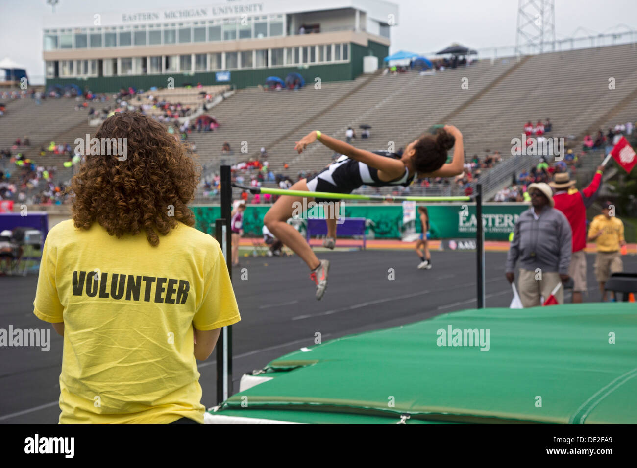 Ypsilanti, Michigan - High jump competition during the track and field events at the AAU Junior Olympic Games. - Stock Image