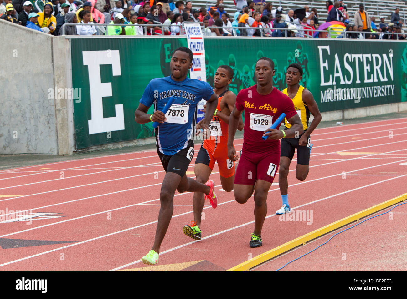 Ypsilanti, Michigan - Relay race competition during the track and field events at the AAU Junior Olympic Games. - Stock Image