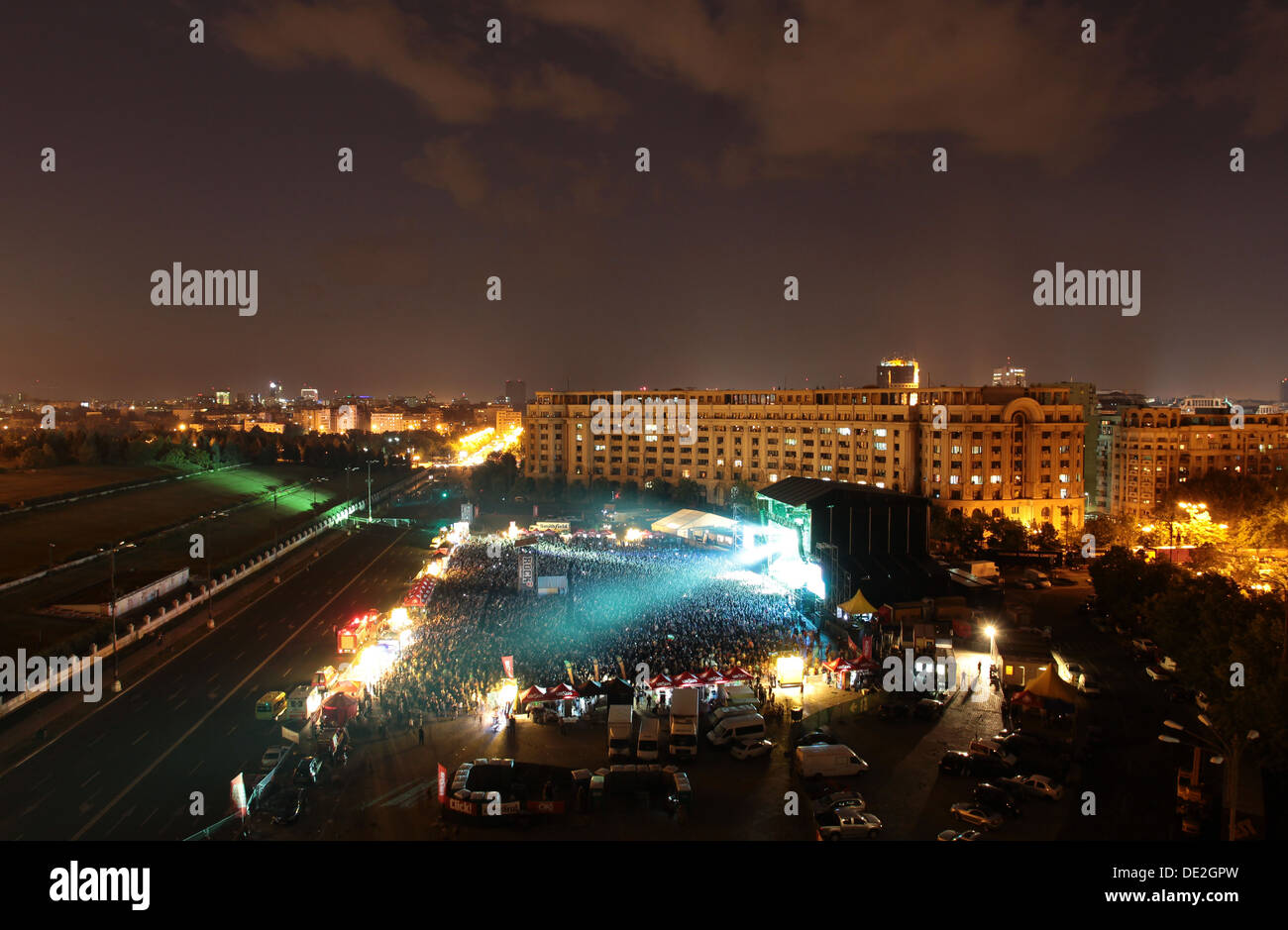 Thousands of people listening to the British group Iron Maiden concert held in the Constitution Square in Bucharest. - Stock Image