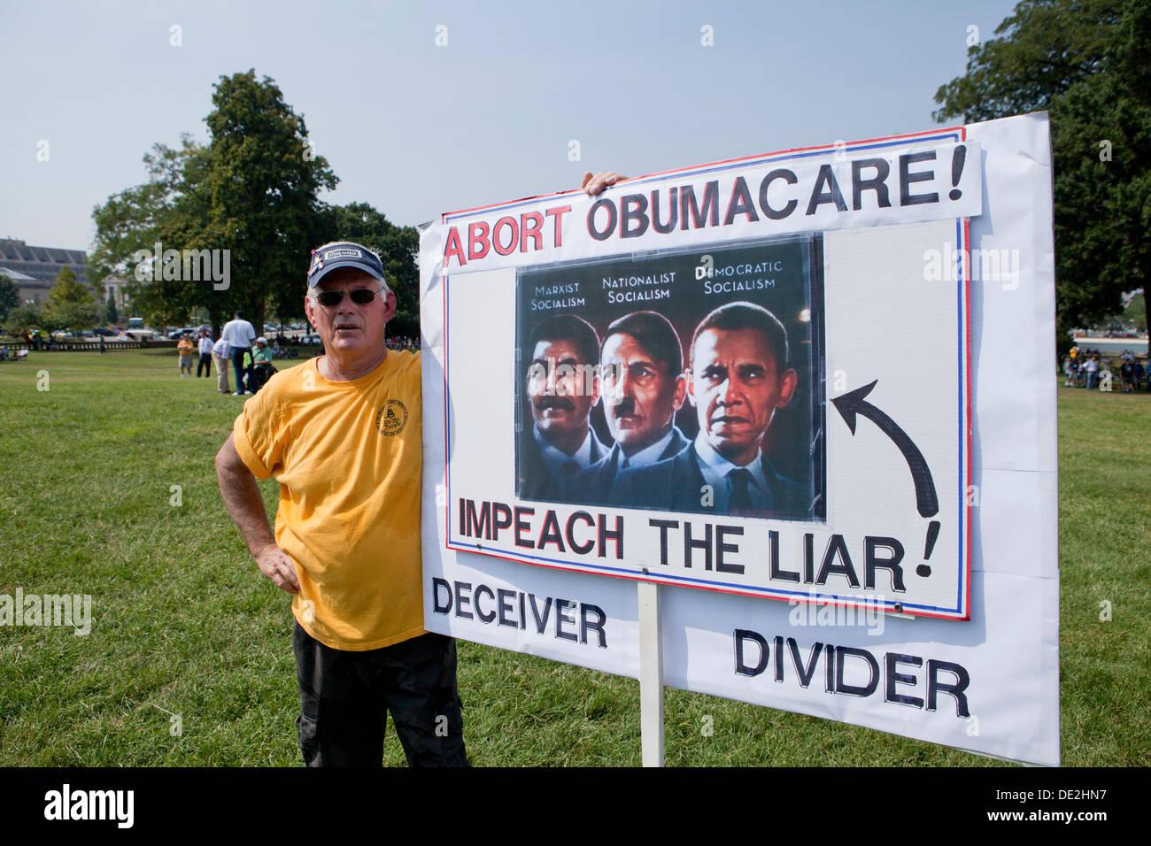 Man holding Anti-Obama sign - Washington, DC USA Stock Photo