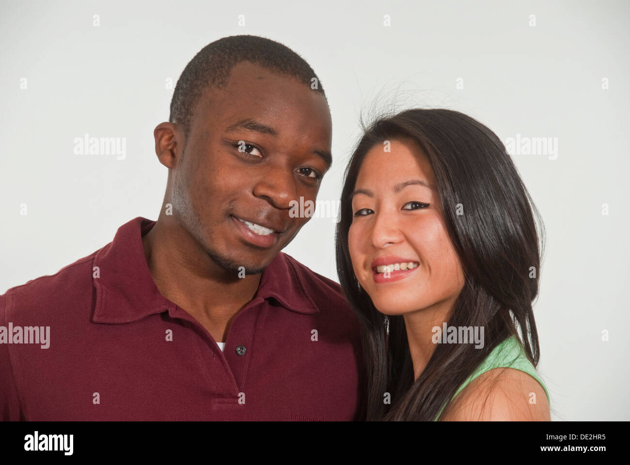 Portrait of young dark-skinned man and young Asian woman - Stock Image