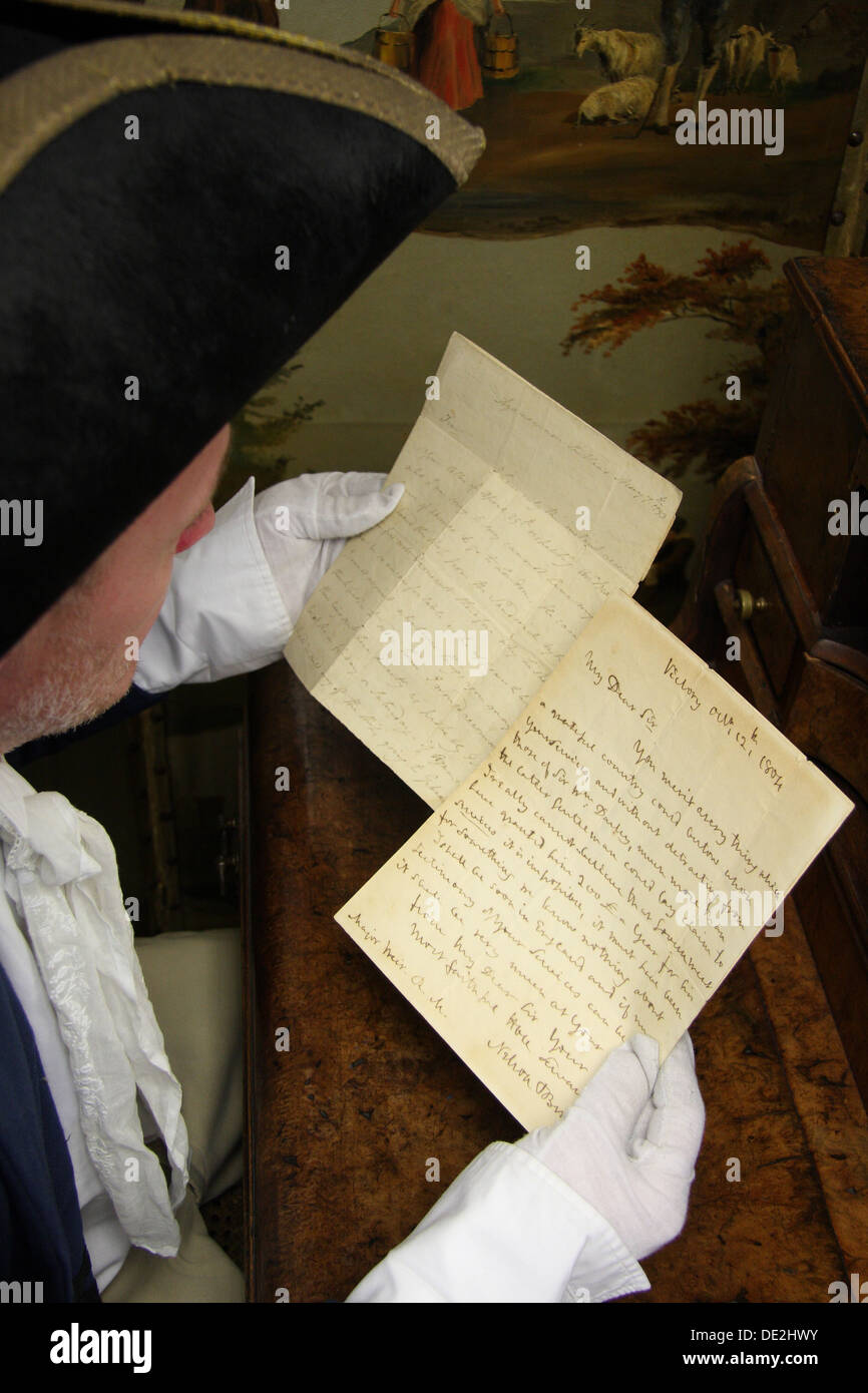 An auctioneer's assistant holds a pair of letters written by Lord Horatio Nelson in readiness for sale at a Derbyshire Stock Photo