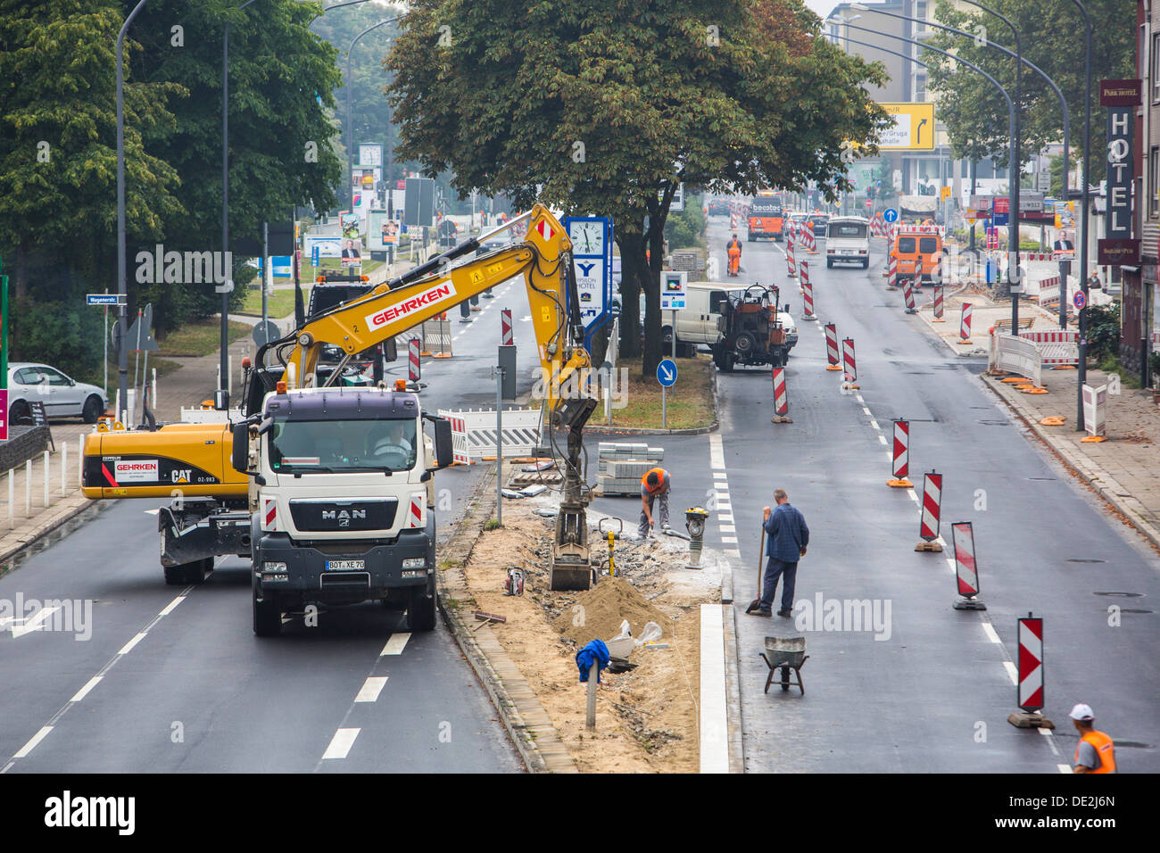Inner-city road construction site. Asphalted work on a major road junction. New asphalt surface. Alfred Street, B224, in Essen. - Stock Image