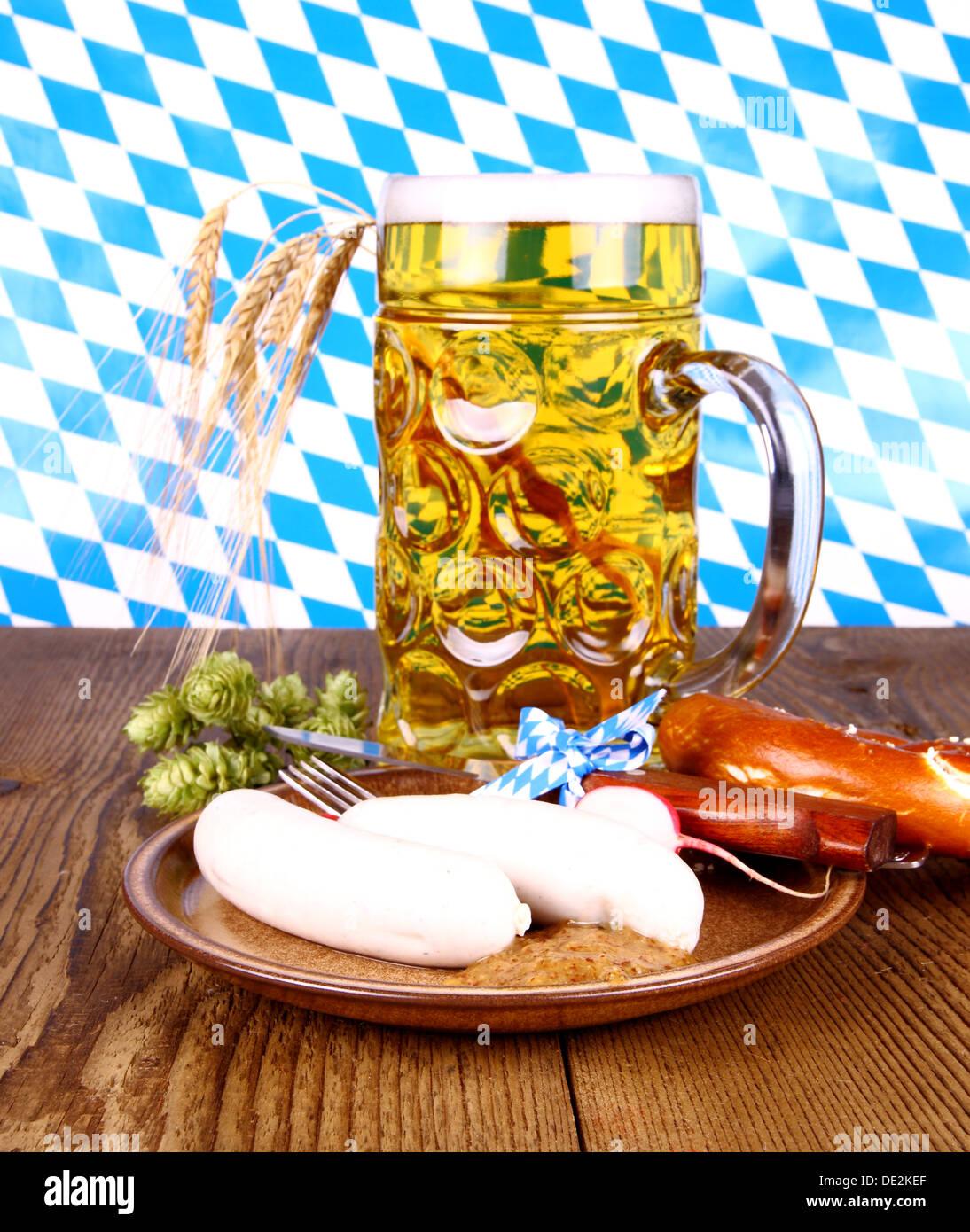 Oktoberfest menu with beer, white sausage, pretzel and radish Stock Photo