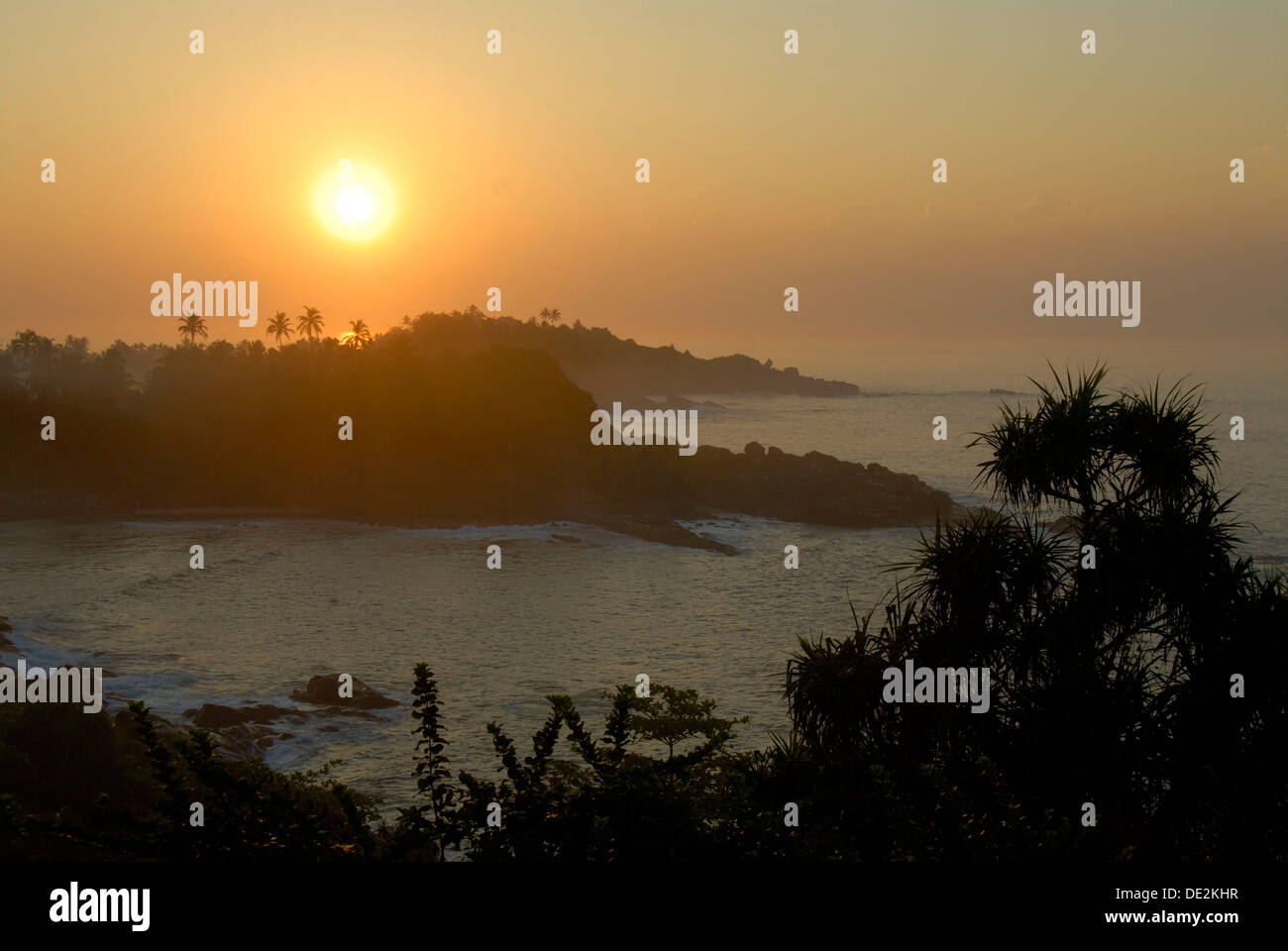 Sunrise over a bay, at Talalla Dondra, Indian Ocean, Ceylon, Sri Lanka, South Asia, Asia - Stock Image