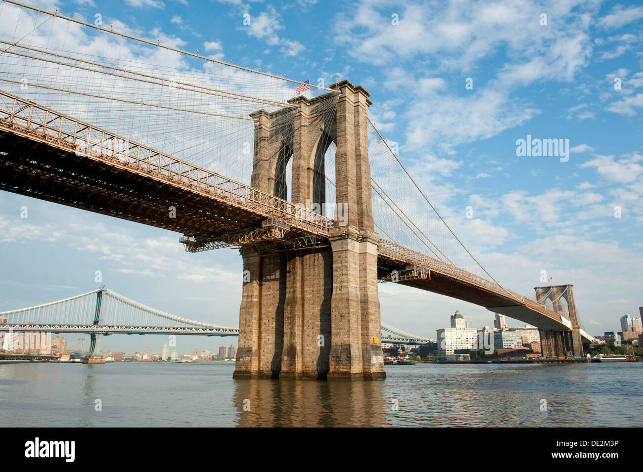 Brooklyn Bridge, a suspension bridge spanning the East River, with the Manhattan Bridge at the rear, Two Bridges District - Stock Image