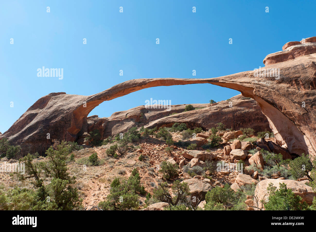 Red sandstone, Landscape Arch, fragile natural stone arch, Arches National Park, Utah, Western United States - Stock Image