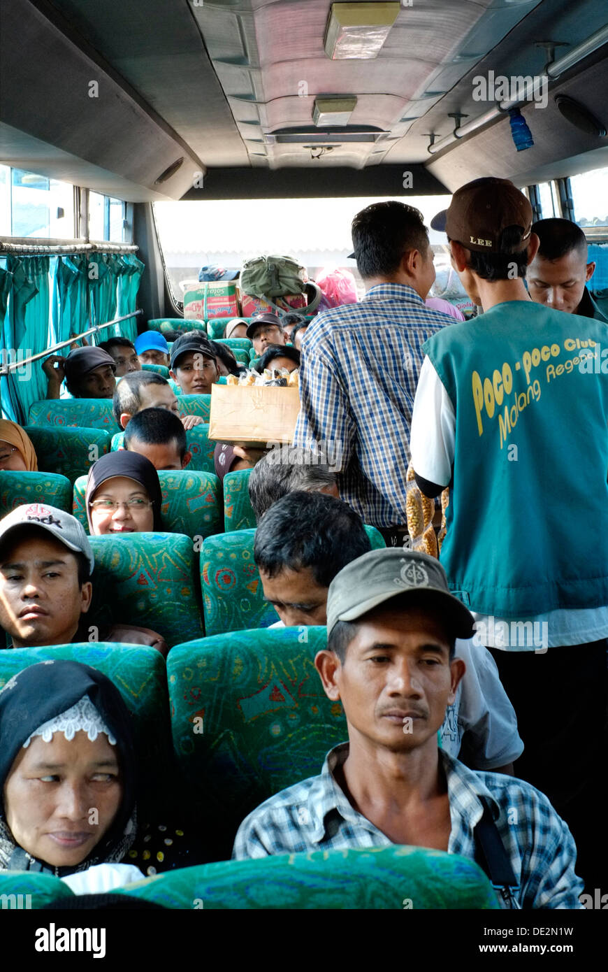 bus passengers and vendors put the public transport infrastructure under strain as the mass idul fitri holidays get underway - Stock Image