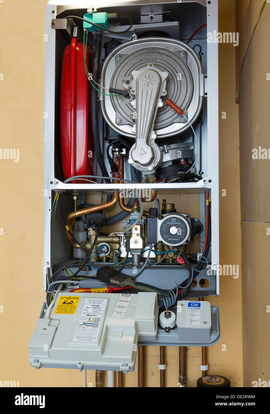 gas boiler with cover removed - Stock Image