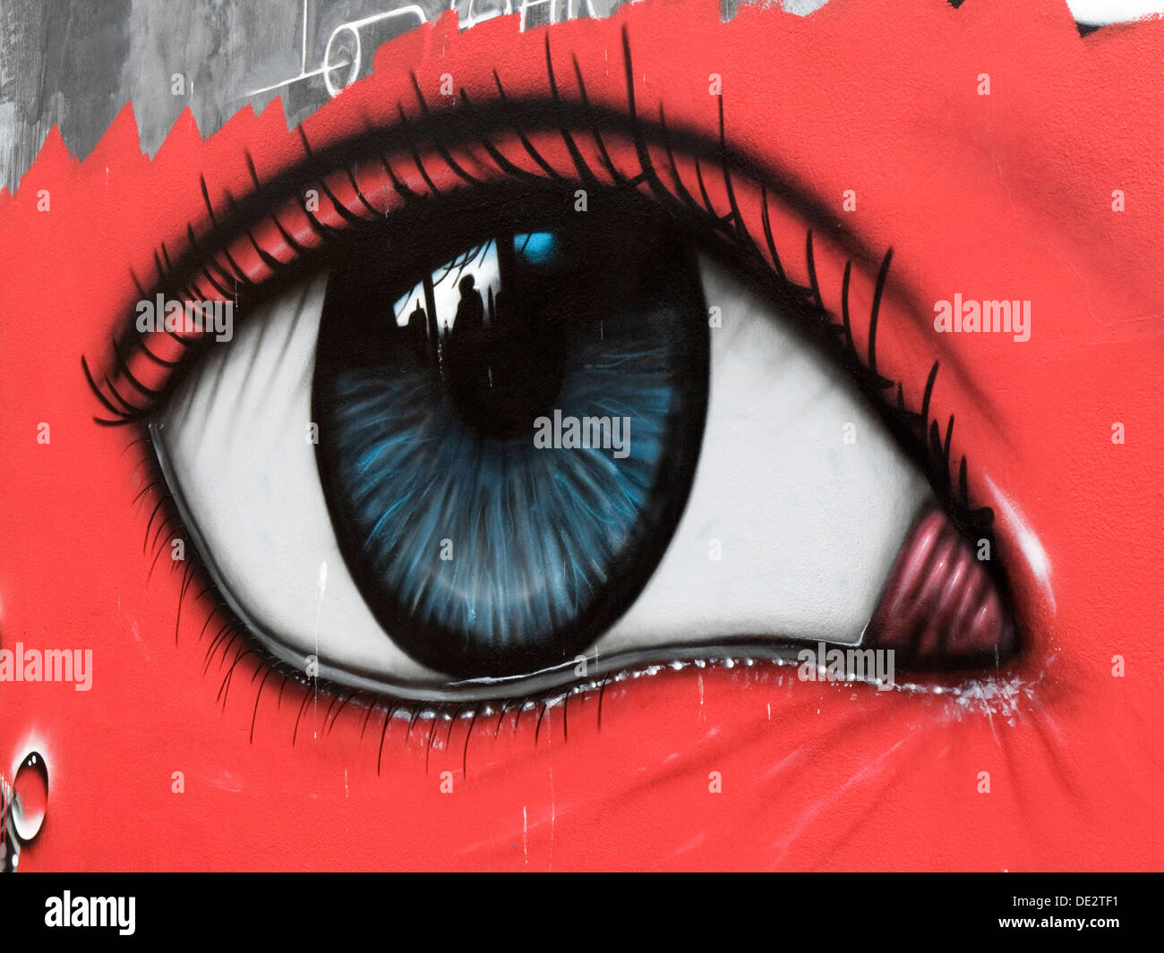 large artwork of an eye painted onto an outside wall southsea england uk - Stock Image