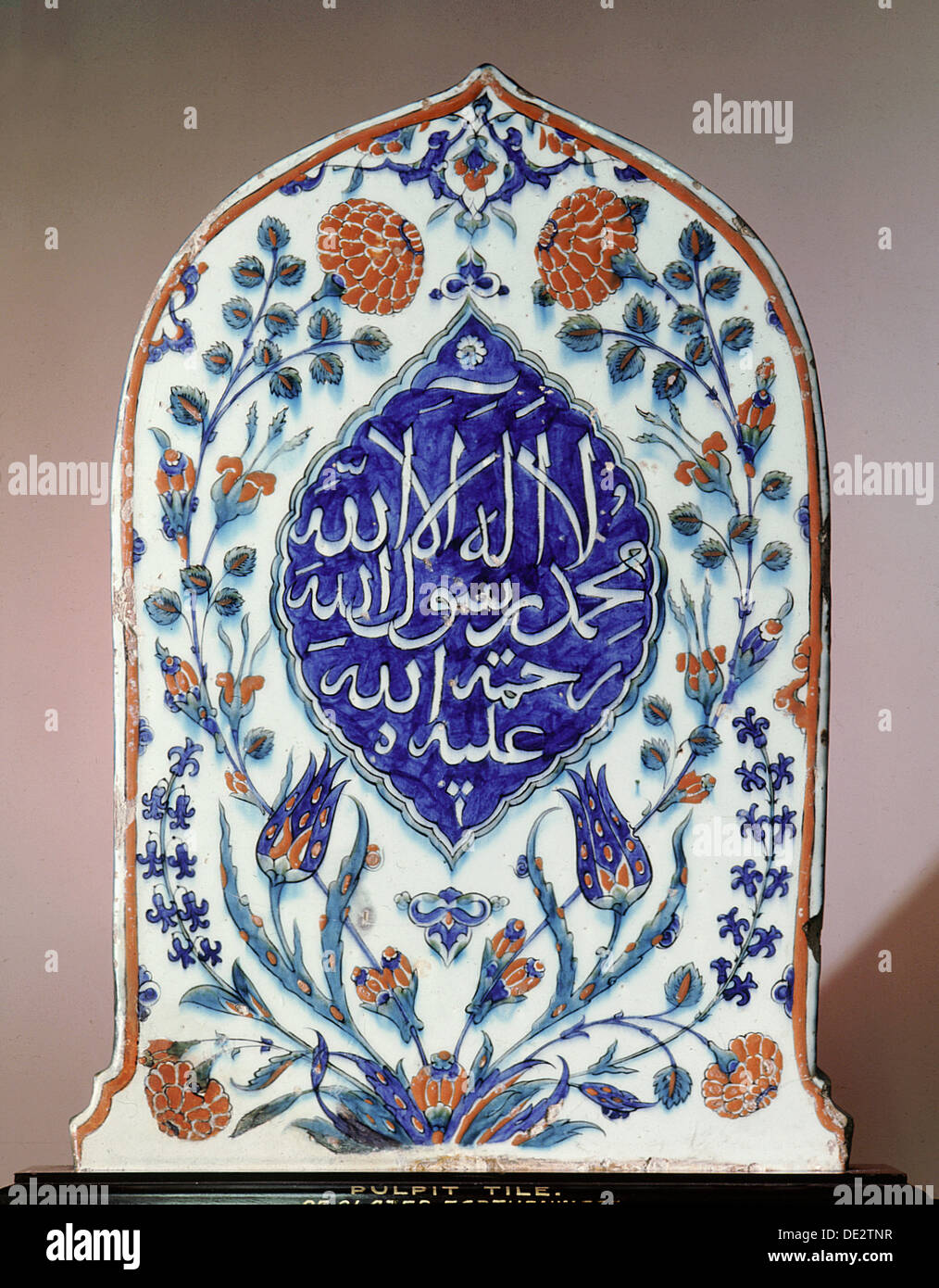 A tombstone-shaped tile, possibly made for a mausoleum, bearing the creed 'there is no God but God; Muhammad is his prophet; may - Stock Image