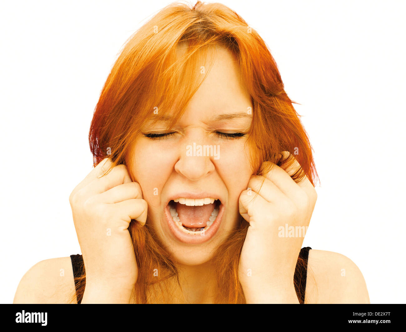 Portrait of a screaming, hysterical young woman - Stock Image