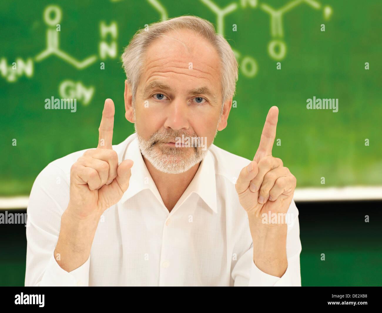 Professor, senior, academic, scientist, teacher, chemistry professor during teaching - Stock Image
