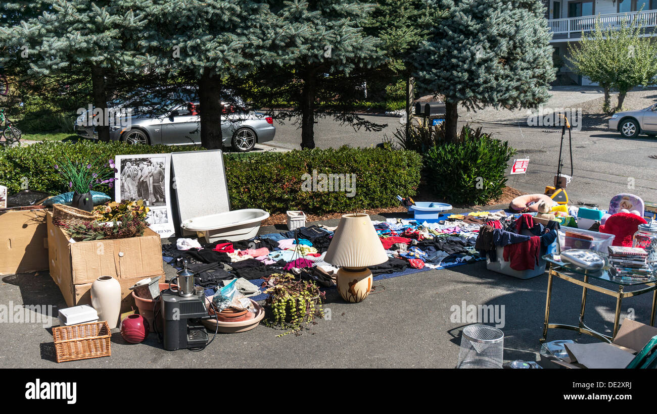 Appealing Collection Of Miscellaneous Household Items Clothing Furniture  Books In Suburban Driveway At Garage Sale Edmonds