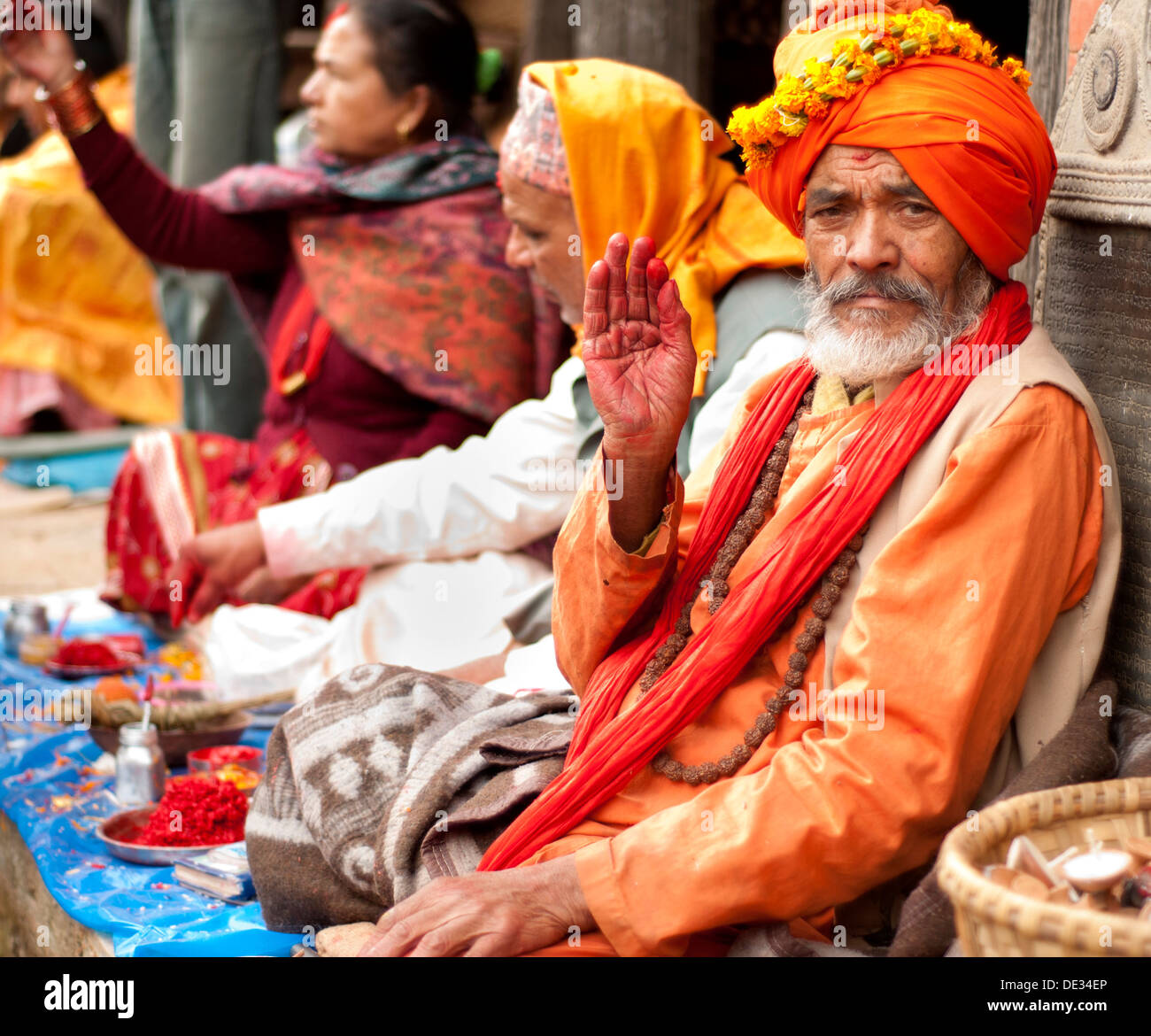 Holy Man Giving Blessing in Nepal. - Stock Image