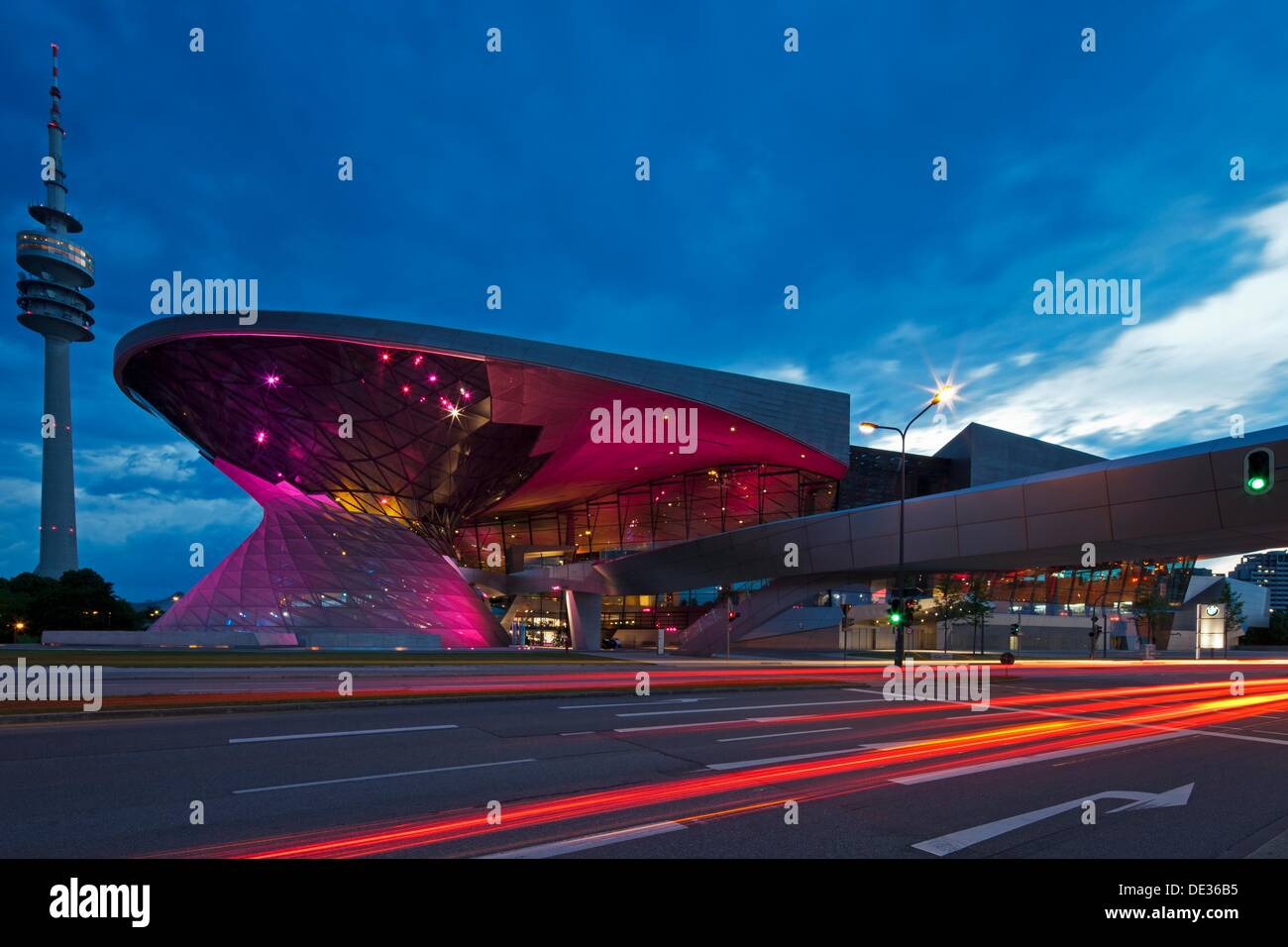 Twilight view of the main entrance to BMW Welt BMW World , a multi-functional customer experience and exhibition facility of - Stock Image