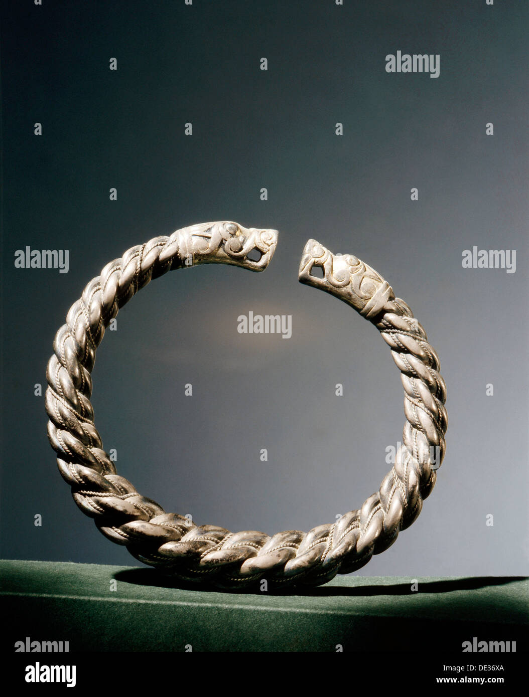 Arm ring, terminating in dragon-heads. - Stock Image