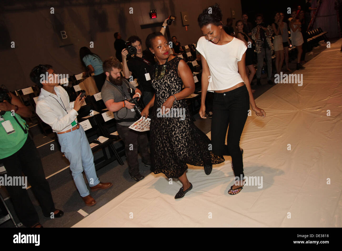 September 8, 2013 - New York, New York, U.S. - Fashion designer TRACY REESE (black lace dress) with models, backstage at Mercedes-Benz Spring 2014 Fashion Week New York. (Credit Image: © Jodi Jones/ZUMA Wire/ZUMAPRESS.com) - Stock Image