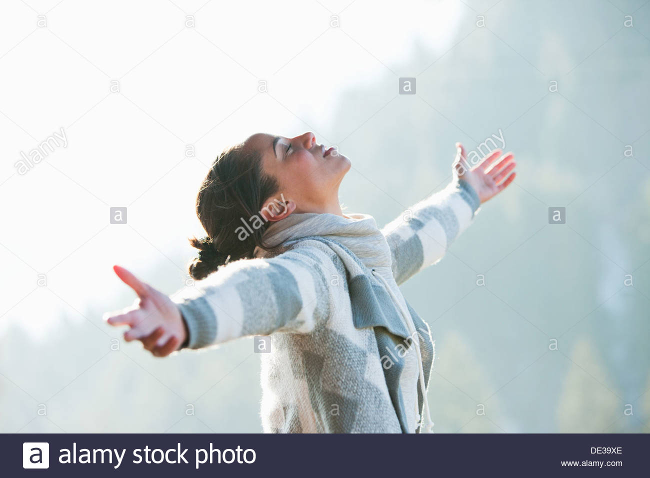 Woman with head back and arms outstretched - Stock Image