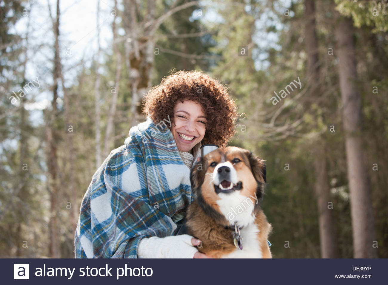 Woman and dog outdoors, winter - Stock Image