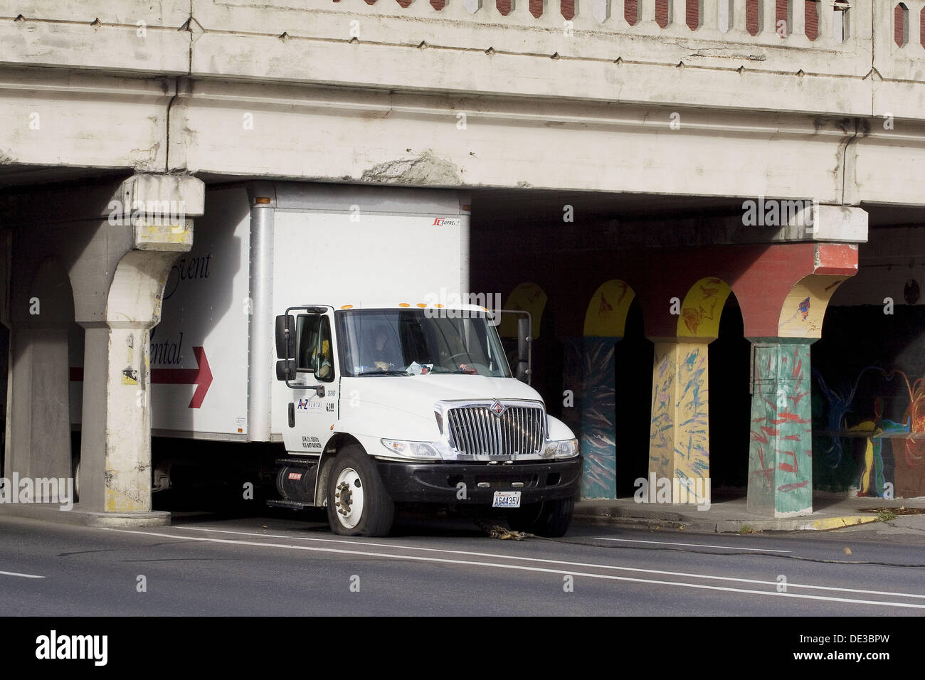 A Truck Stuck Under A Railroad Overpass The Air Has Been Let Out Of