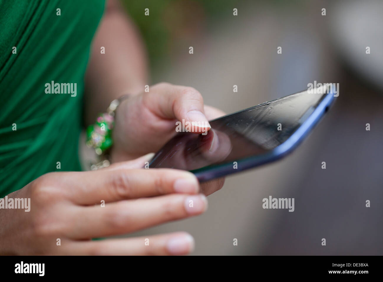 Closeup of woman using smart phone - Stock Image