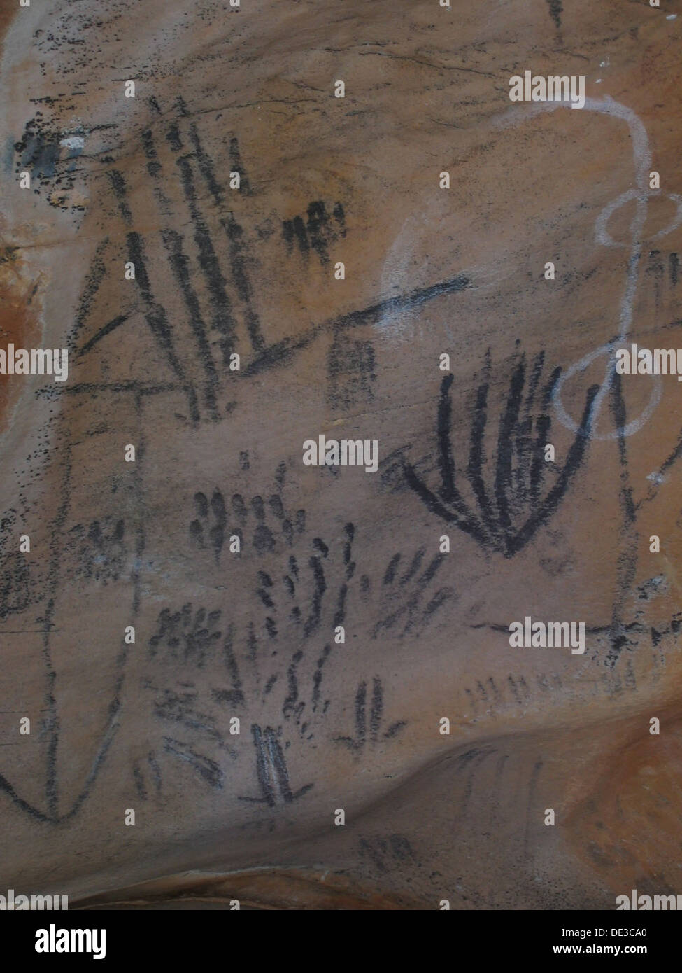 Rock paintings thought to relate to the dreaming or ceremonies associated with the site. - Stock Image