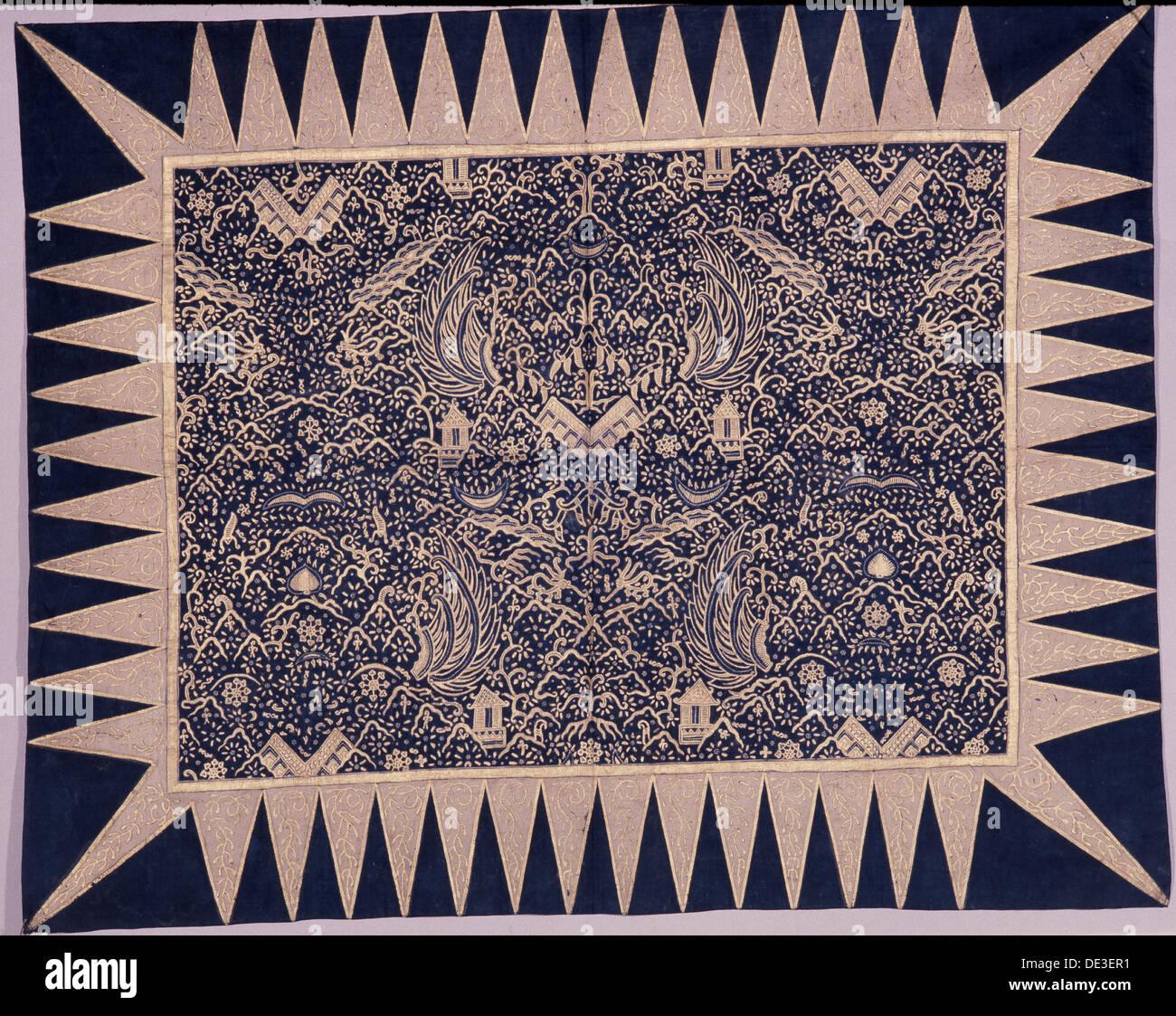 A batik kain depicting stylised wings, shrines and sacred mountains. - Stock Image