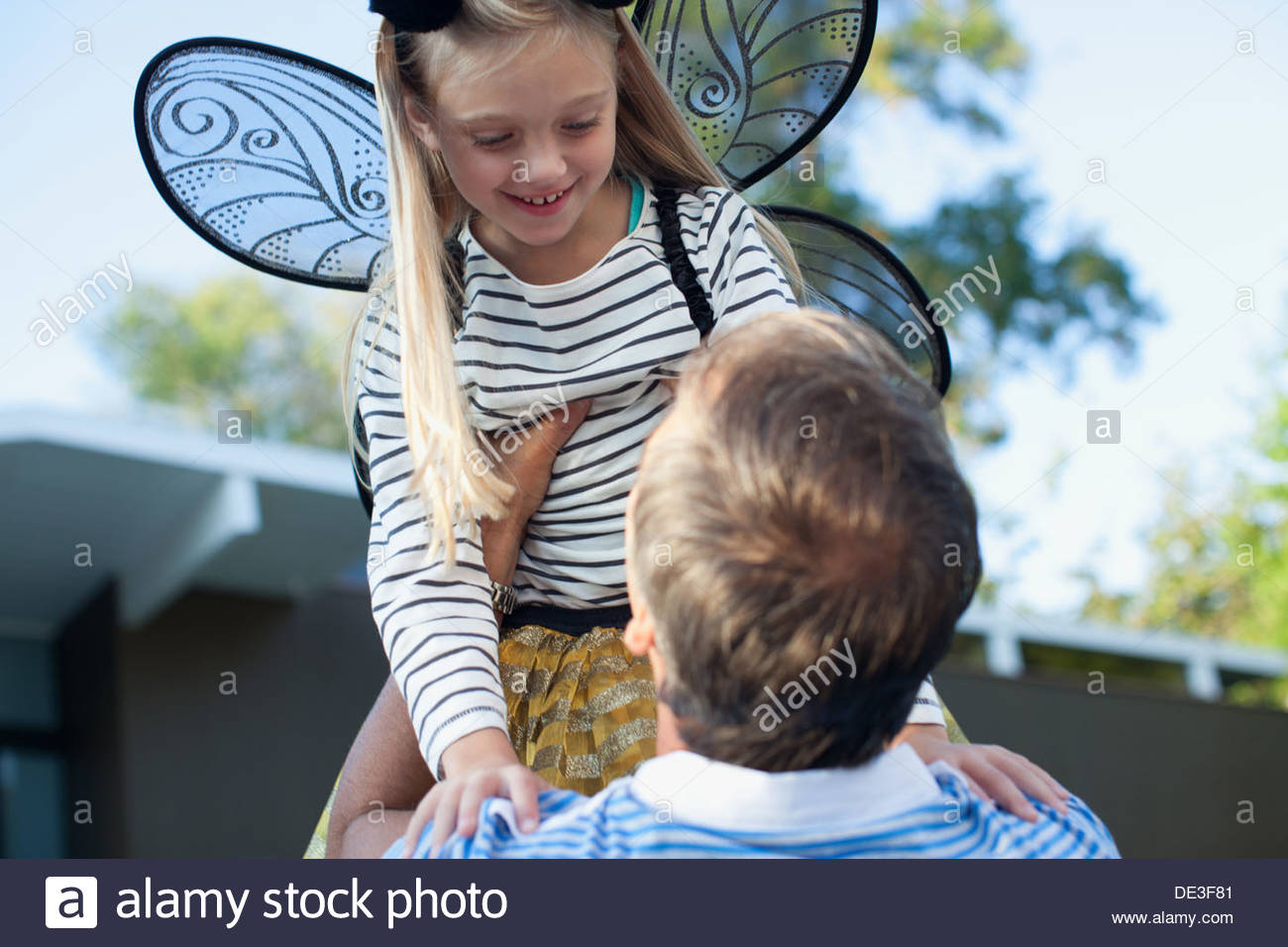 Father lifting daughter in air outdoors Stock Photo