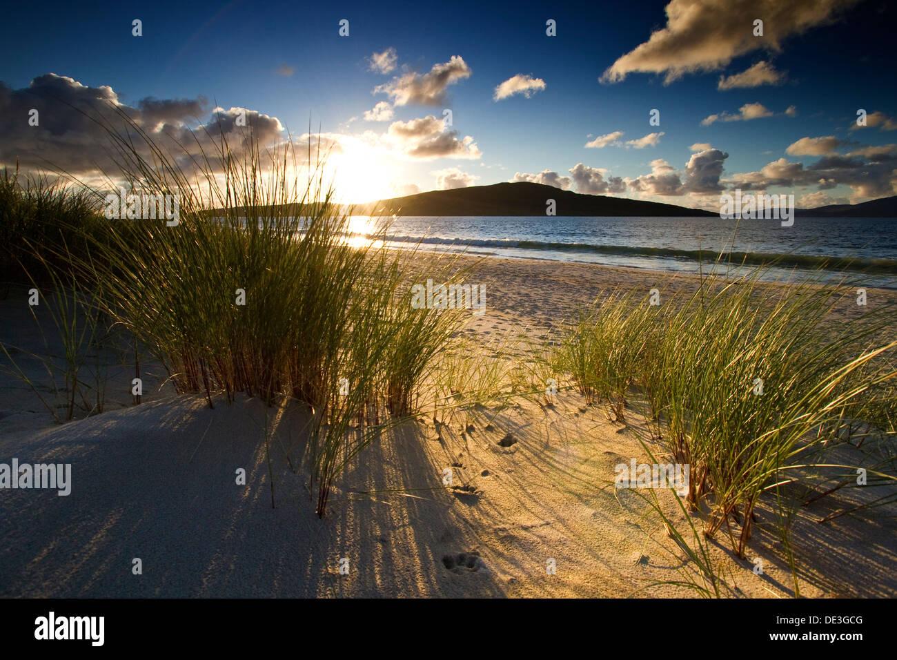 Sunset on Luskentyre Beach on the Isle of Harris, Scotland. Taken looking towards the Island of Taransay - Stock Image