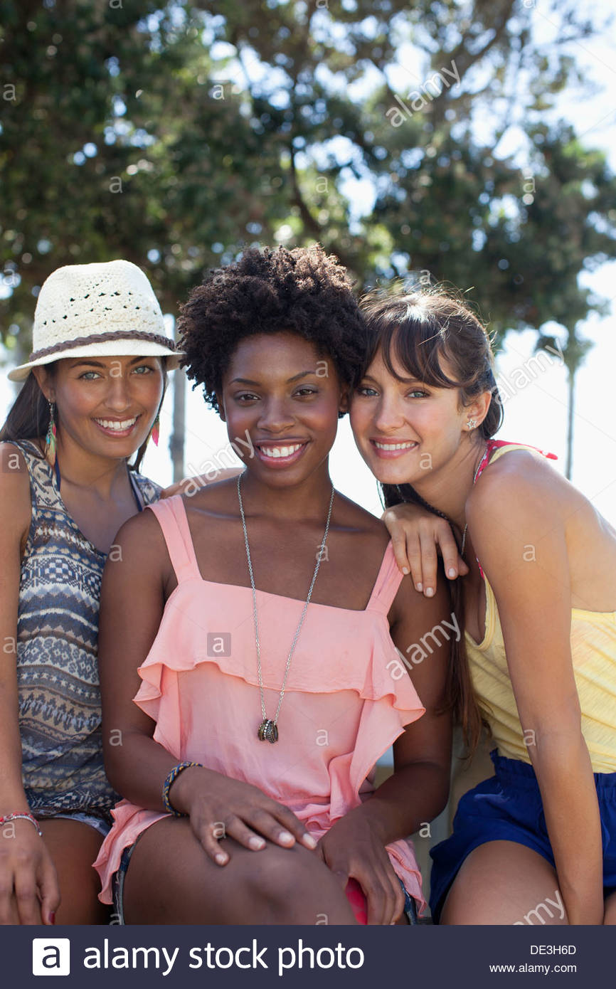 Women smiling together outdoors Stock Photo
